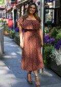 Kelly Brook wears a cute polka dot dress with a smile as she leaves Global Studios in London, UK