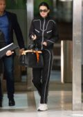 Kendall Jenner keeps it casual yet trendy with an all black tracksuit and white Yeezy sneakers as she steps out in New York City