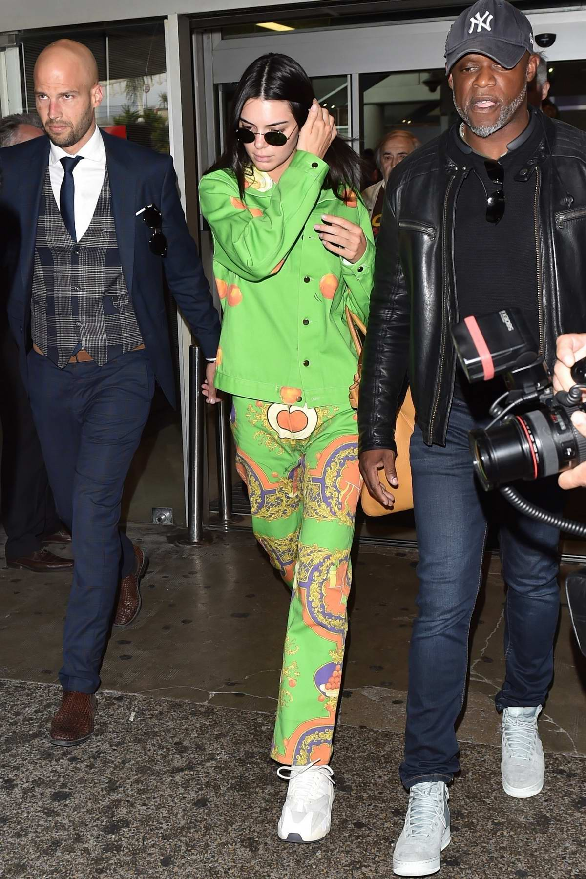 Kendall Jenner dons a bright green outfit as she touches down at Nice Airport for the 72nd annual Cannes Film Festival, France
