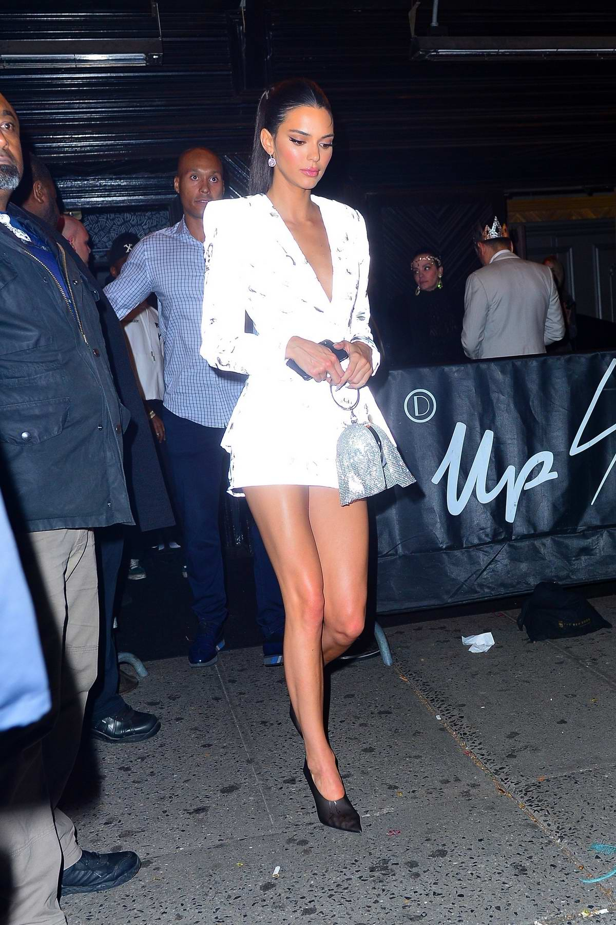 Kendall Jenner glows in a short white outfit as she heads to the 2019 Met Gala after-party in New York City