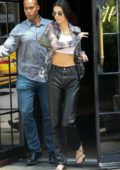 Kendall Jenner shows off her toned tummy as she steps out in New York City