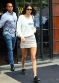 Kendall Jenner wears a 'Cowboy' sweater with a mini skirt as she heads out for lunch at Cipriani's New York City