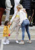 Khloe Kardashian greets a friend at Kanye West's Sunday church services in Calabasas, California