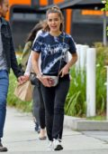 Kiernan Shipka sports a casual look while out with a friend in Los Angeles