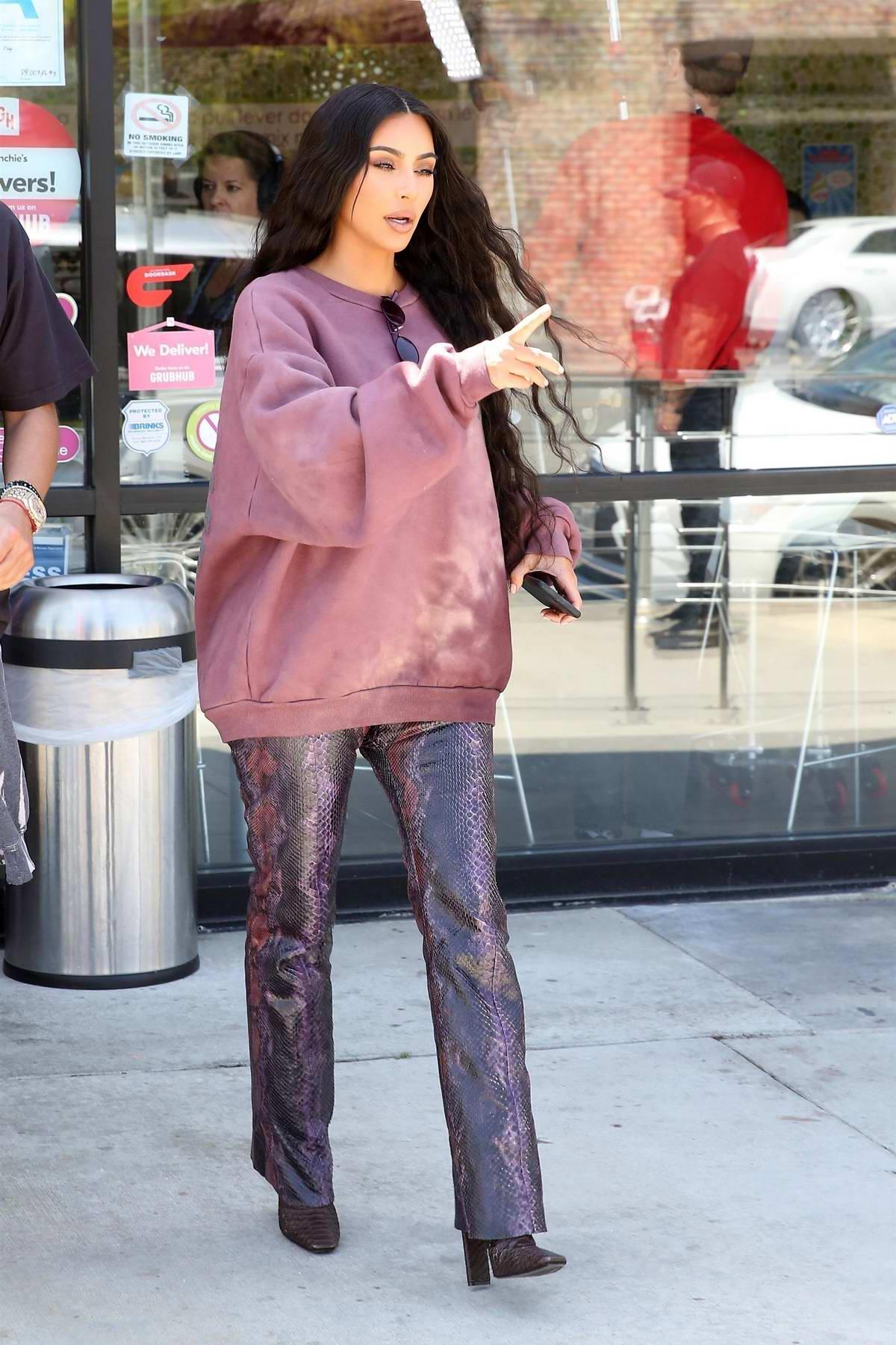 Kim Kardashian and Jonathan Cheban grab a treat together at Menchie's In Calabasas, California