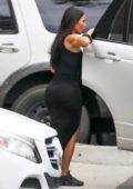 Kim Kardashian and Kanye West arrive for Sunday church services in Calabasas, California