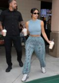 Kim Kardashian grabs a couple of milkshakes from BurgerIM in Calabasas, California
