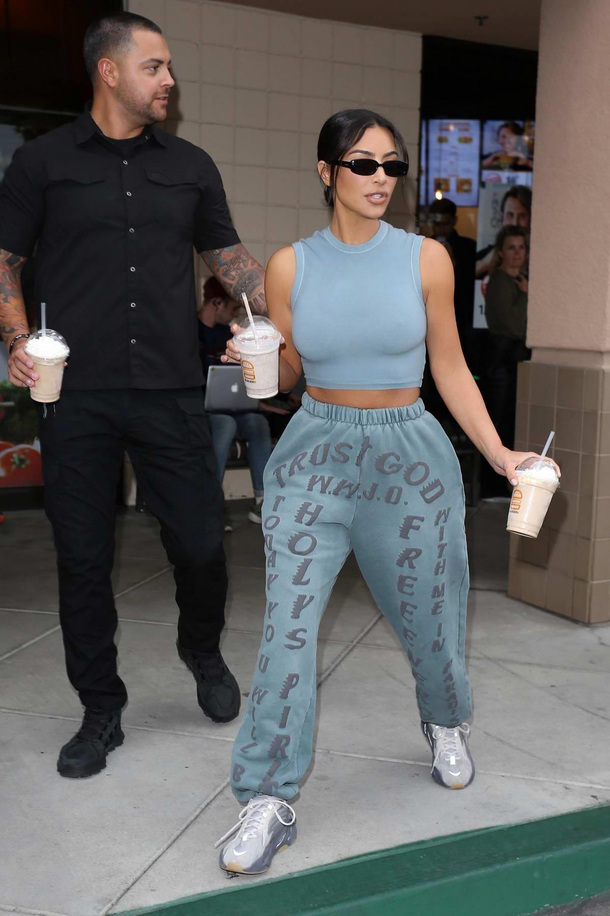 Kim Kardashian grabs a couple of milkshakes from BurgerIM in Calabasas, California