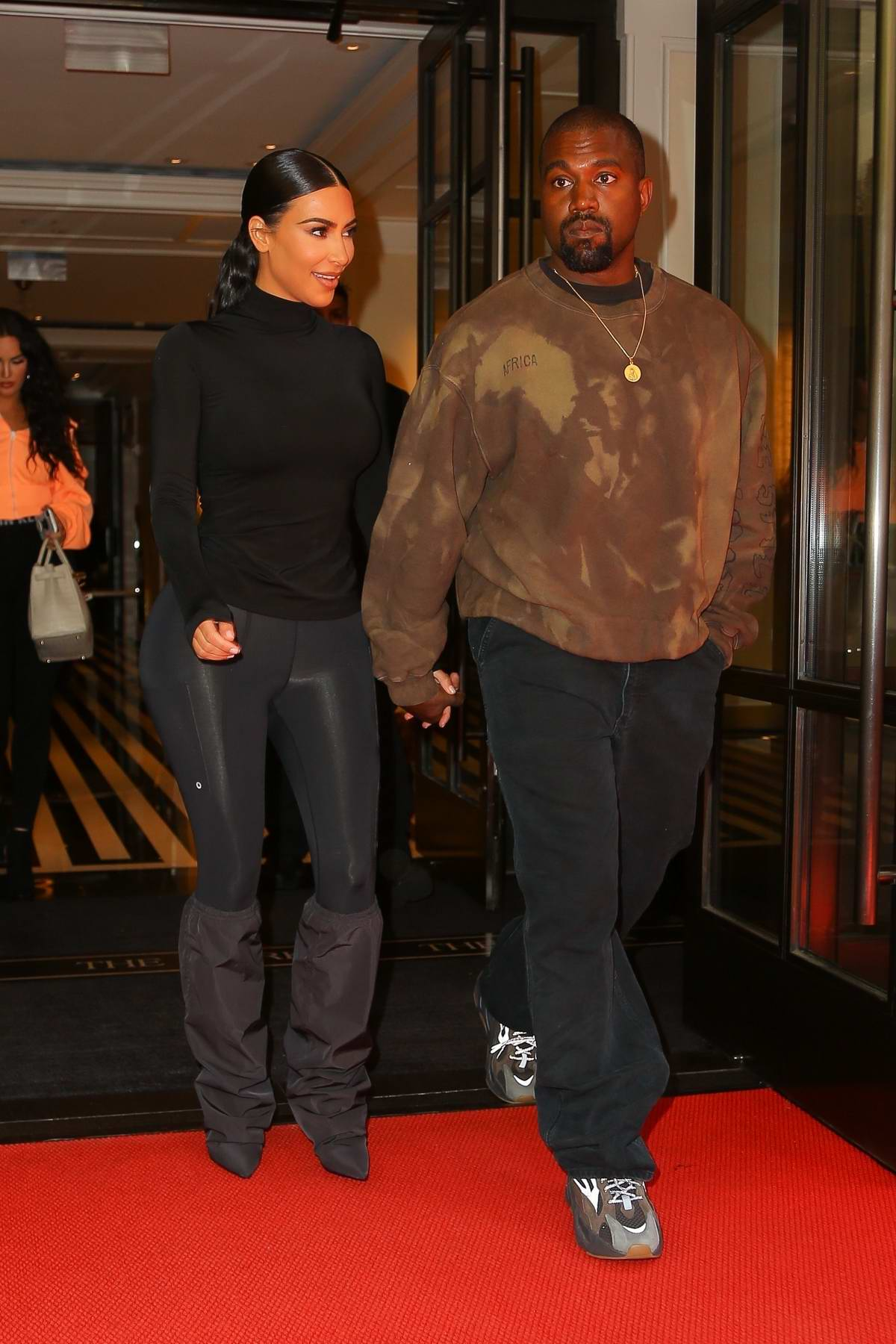 c927833c6d78 Kim Kardashian hold hands with Kanye West as they exit their hotel in New  York City