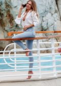 Kimberley Garner spotted in a white shirt and jeans while chatting on her phone at Hotel du Cap-Eden-Roc in Antibes, France