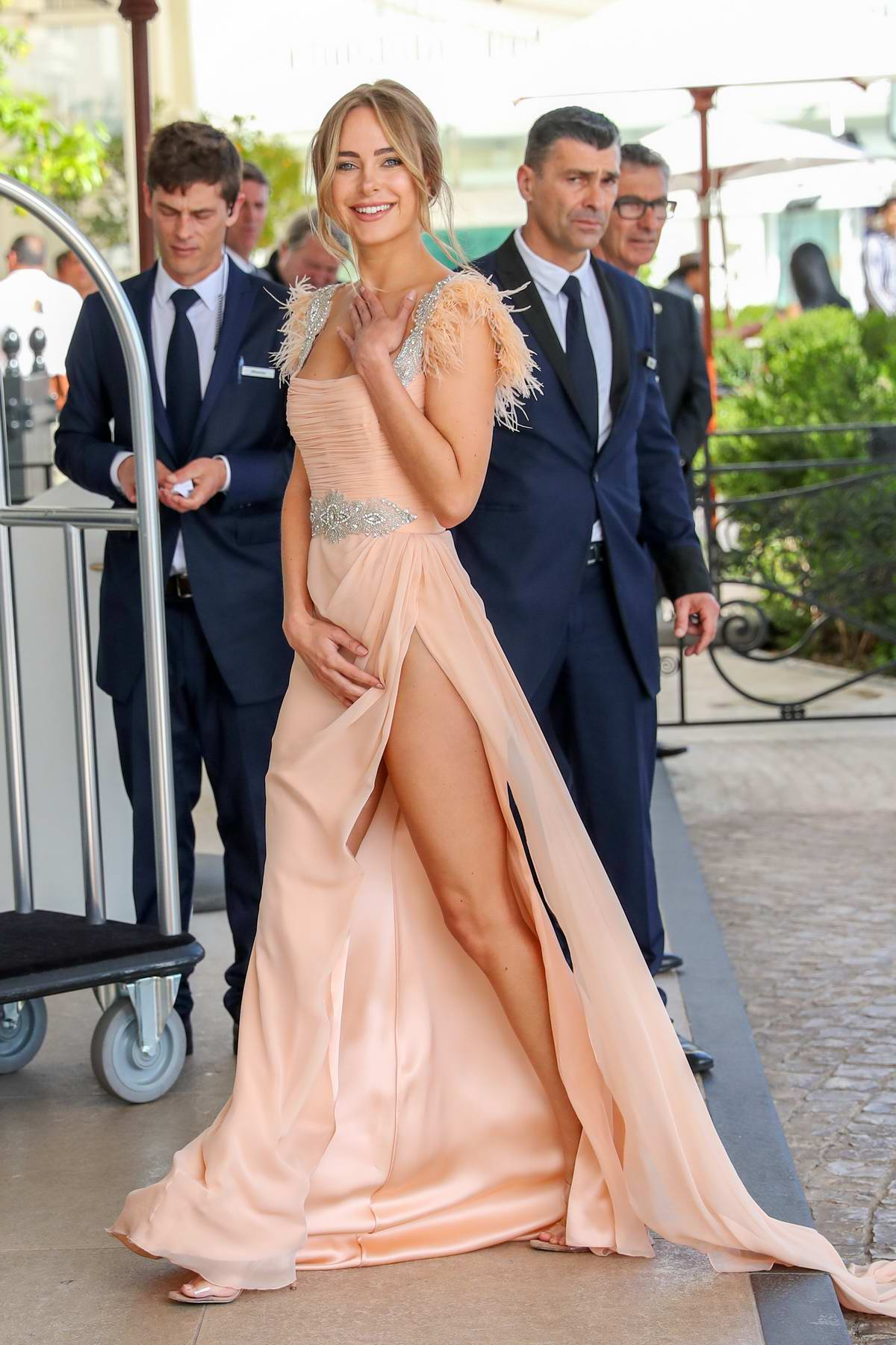 Kimberley Garner stuns in a peach gown as she steps out during the 72nd annual Cannes Film Festival in Cannes, France