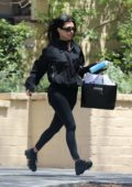 Kourtney Kardashian runs to her car after visiting a friend in West Hollywood, Los Angeles
