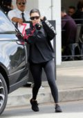 Kourtney Kardashian seen wearing a black Adidas sweatshirt and leggings as she leaves Joan's On Third in Los Angeles