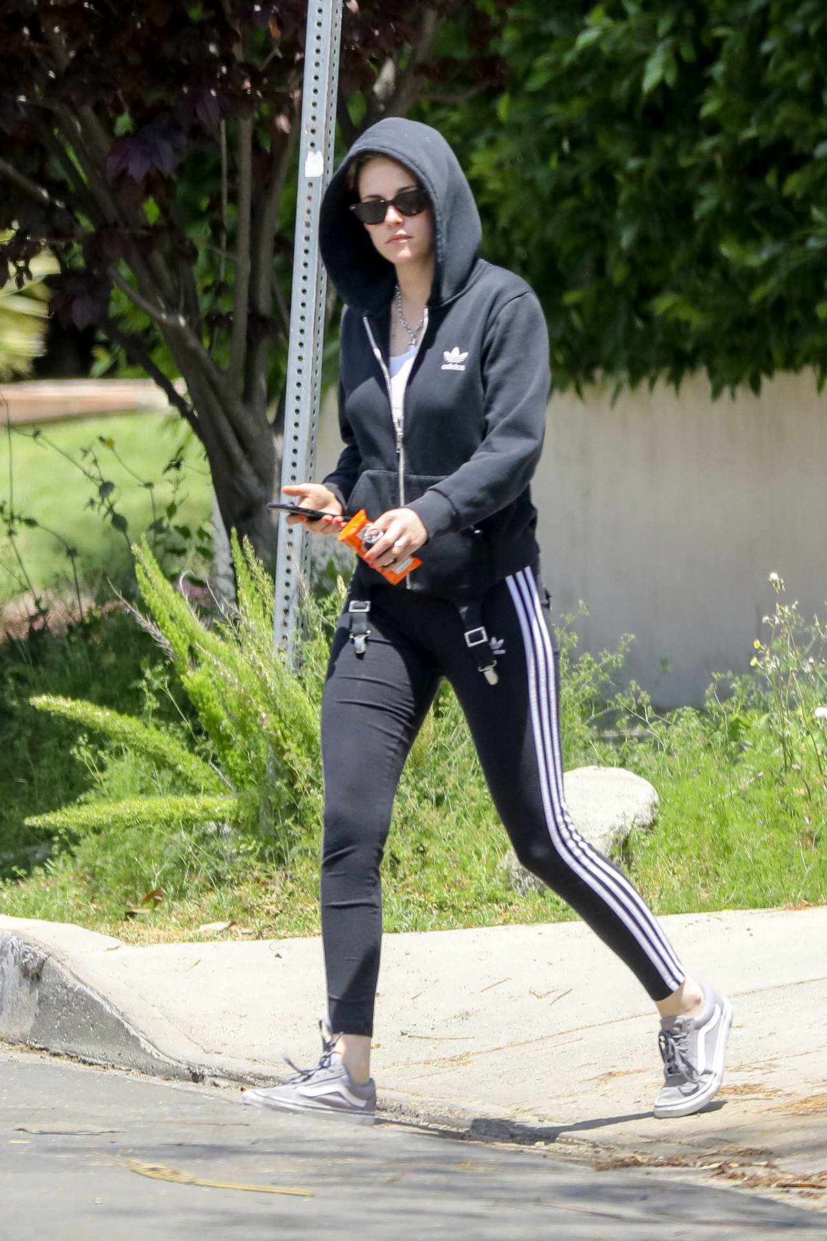 Kristen Stewart dons an all Adidas workout gear as she hits the gym in Los Feliz, California