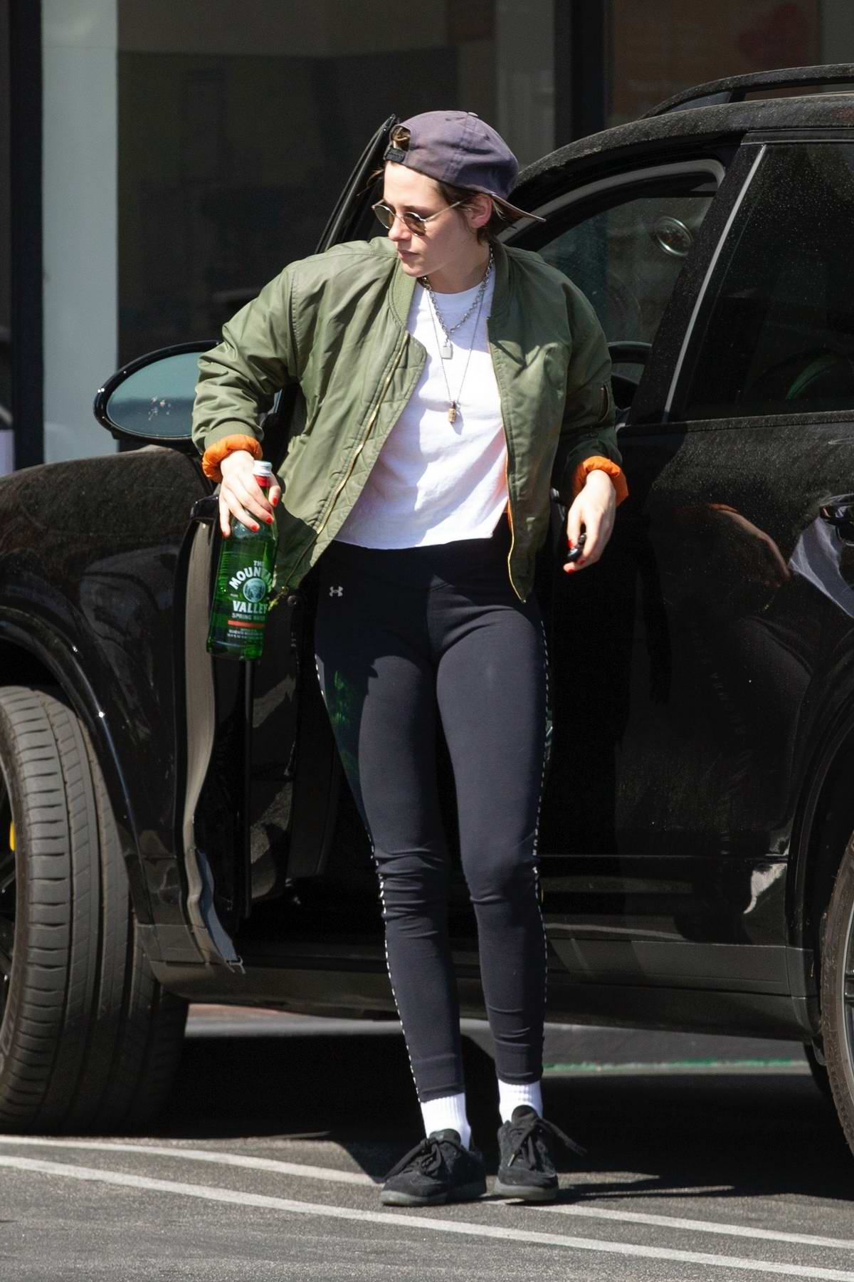 e5640cc95f kristen stewart sports a green jacket with black under armour leggings as she  leaves a health spa in hollywood, california-300419_2