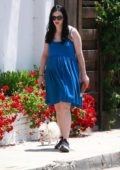 Krysten Ritter wears a blue dress as she steps out for an afternoon stroll with her dog in Los Angeles