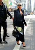 Lady Gaga dons all black as she steps out with flower bouquet in New York City