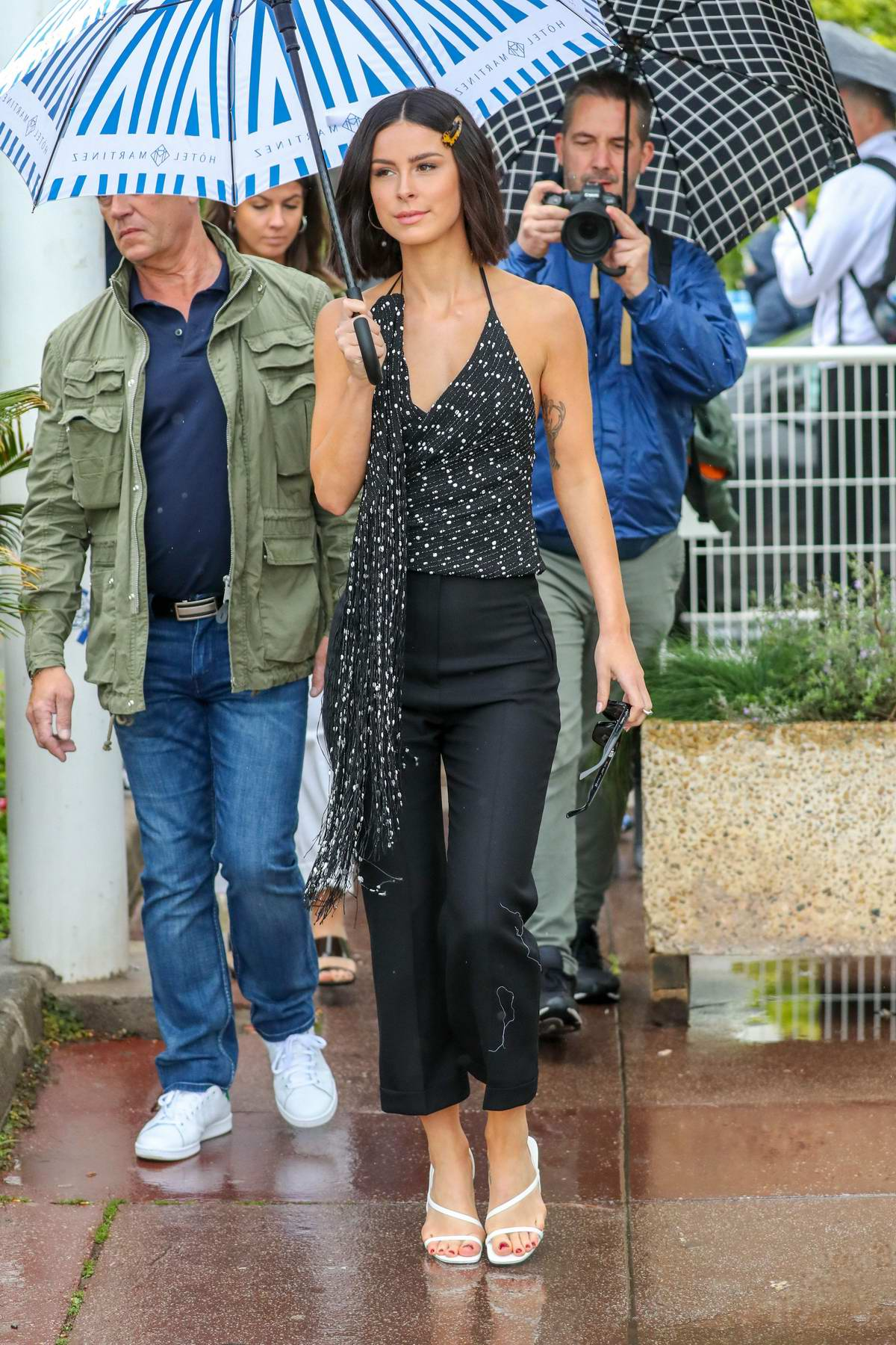 Lena Meyer-Landrut steps out in the rain on the Croisette with an umbrella during the 72nd Cannes Film Festival in Cannes, France