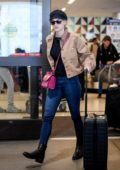 Lili Reinhart looks cool in a brown denim jacket and blue skinny jeans as she arrives at LAX in Los Angeles