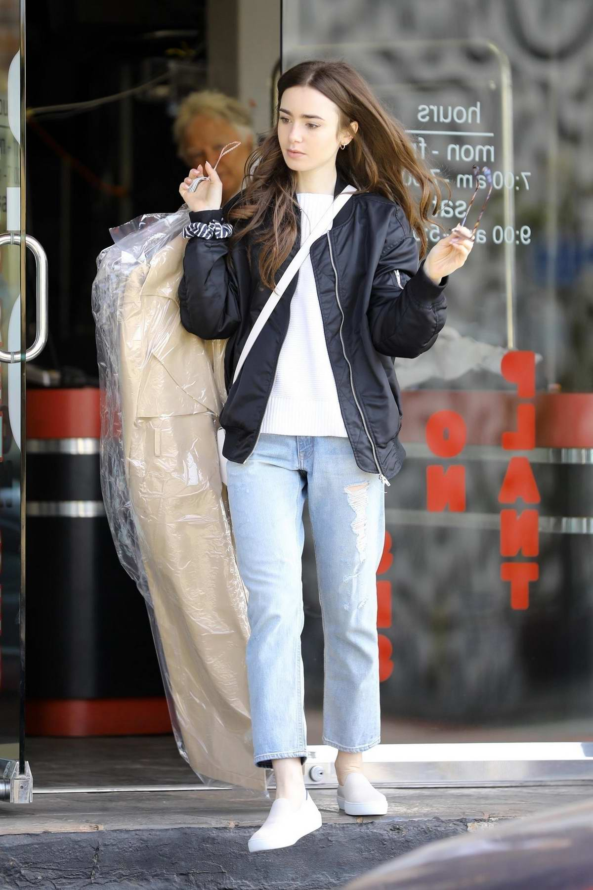 Lily Collins keeps it casual while picking up some dry cleaning in Los Angeles