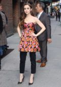 Lily Collins poses for the camera as she arrives at 'The Late Show with Stephen Colbert' in New York City