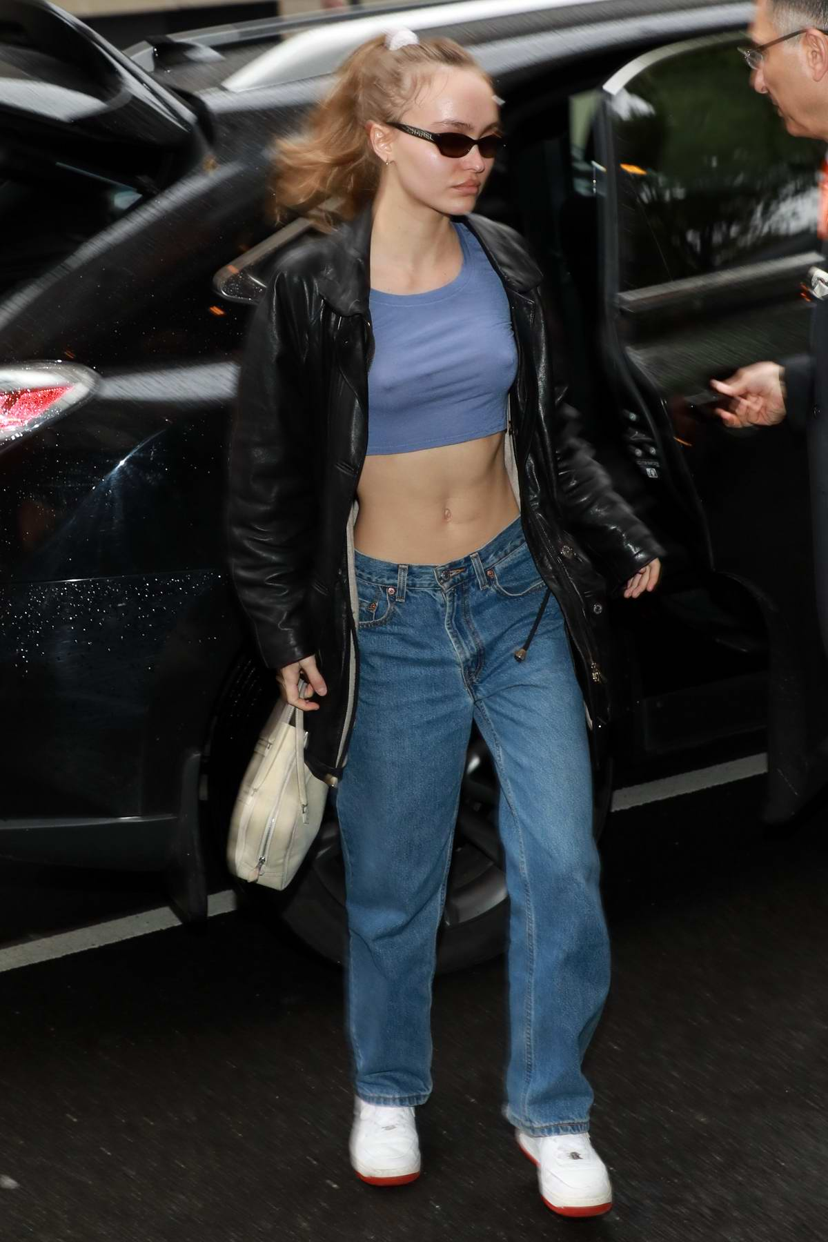 Lily-Rose Depp flaunts her toned abs in a blue crop top as