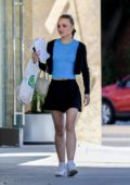 Lily-Rose Depp rocks a short skirt with a baby blue top while out running errands in Beverly Hills, Los Angeles