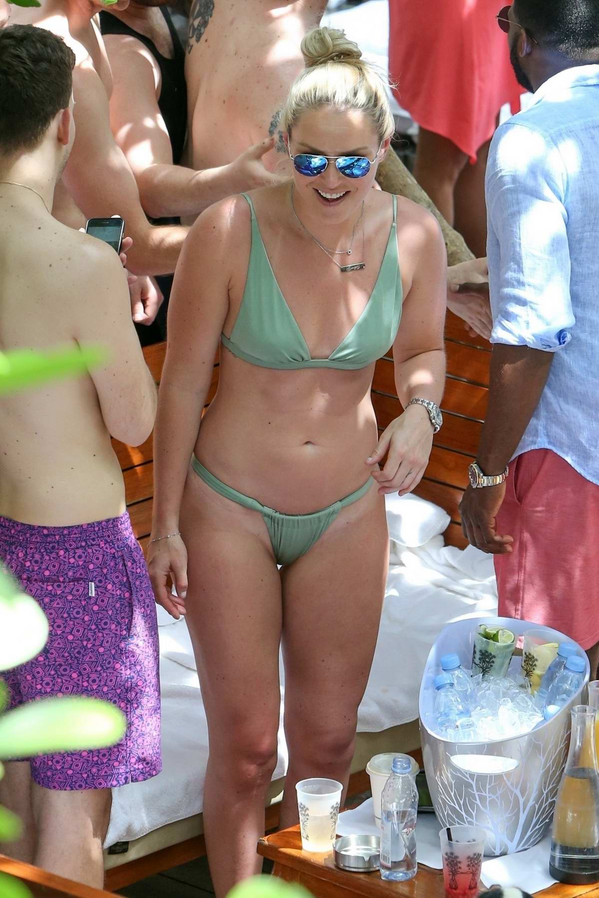 Lindsey Vonn spotted in a green bikini while enjoying a pool party with boyfriend P.K. Subban in Miami, Florida