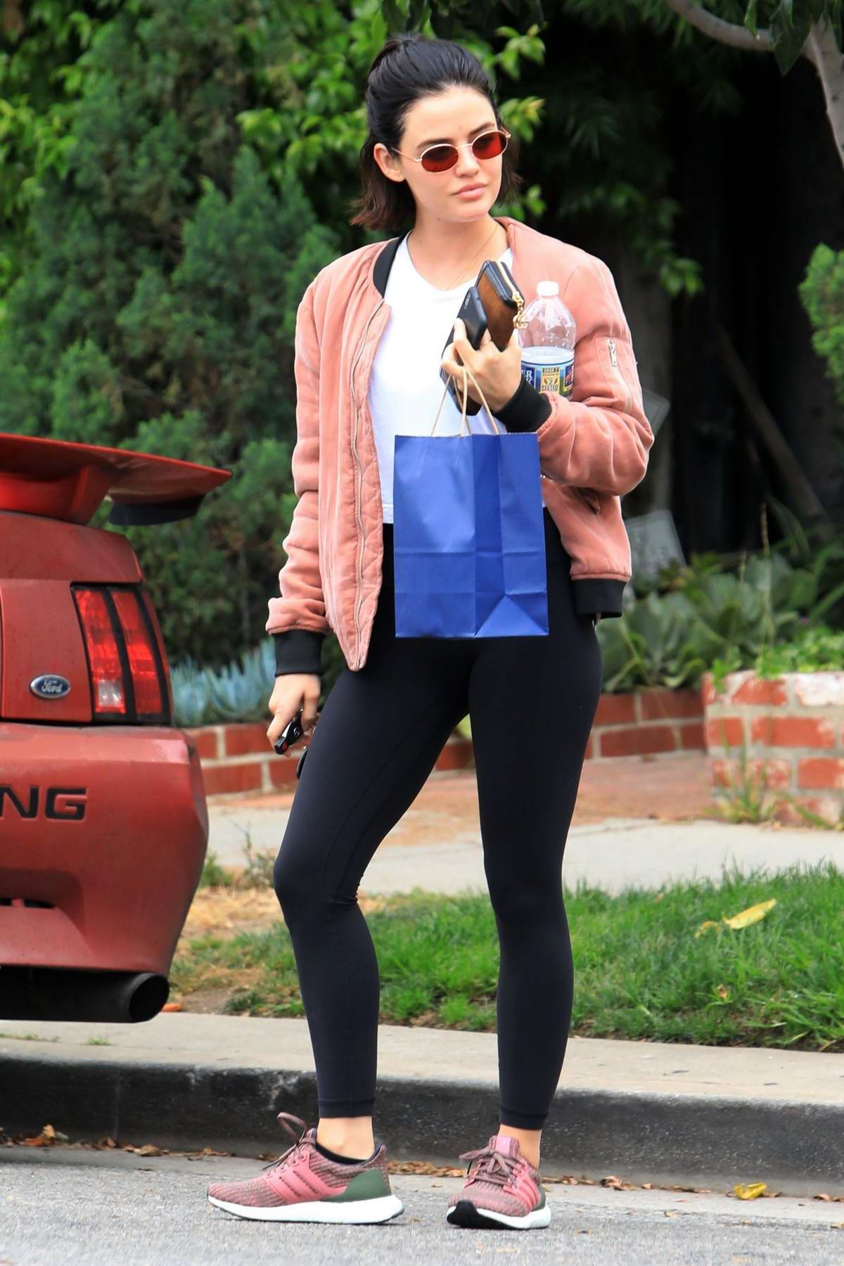 Lucy Hale gets a parking ticket while at Le Jolie Medi Spa in West Hollywood, Los Angeles