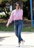 Lucy Hale looks pretty in a pink sweater and jeans as she stops by for a coffee in Studio City, Los Angeles