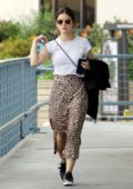 Lucy Hale looks pretty in a white top paired with an animal print skirt while visiting a nail salon in Los Angeles