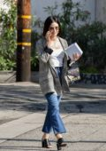 Lucy Hale makes a call as she leaves after getting a massage in Studio City, Los Angeles