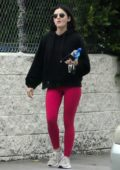 Lucy Hale sports a black hoodie and bright pink leggings as she heads to the gym in Studio City, Los Angeles