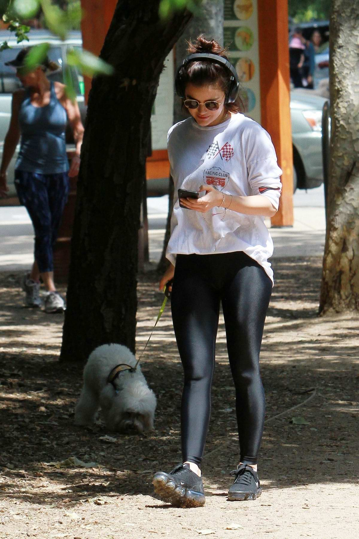 Lucy Hale spotted in white racing sweatshirt and black leggings as she takes her dog for a walk in Los Angeles