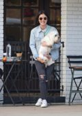 Lucy Hale takes a break to relax over coffee with friends in Los Angeles