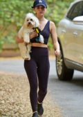 Lucy Hale wears cropped tank top and leggings as she takes her dog out for hike in Los Angeles