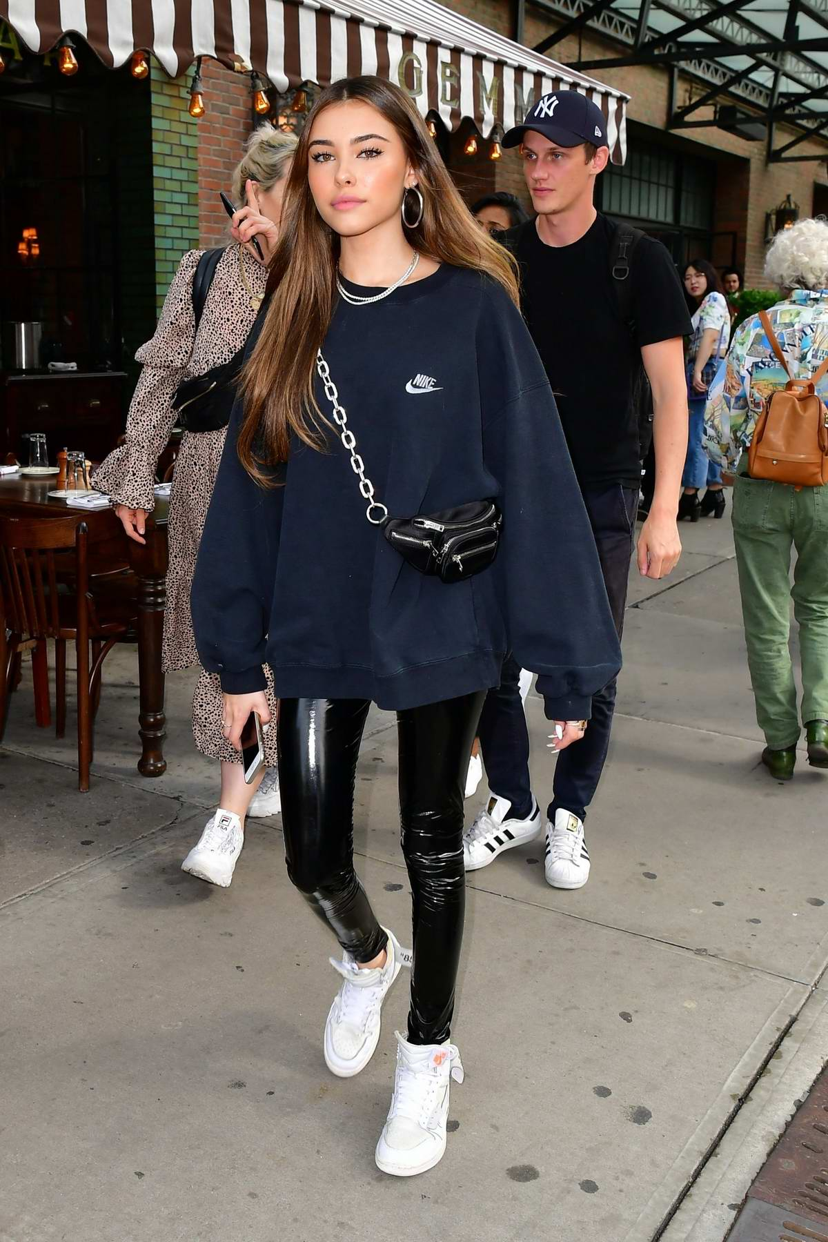 Madison Beer dons a Nike sweatshirt, PVC pants with Off-White Jordan 1 sneakers as she steps out in New York City