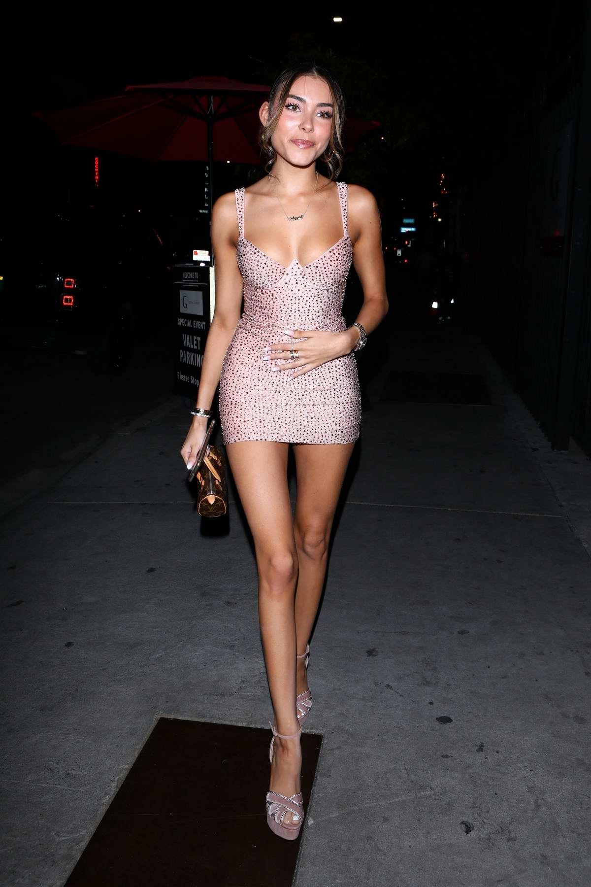 Madison Beer stuns in a form-fitting pink minidress while attending the launch event of 'Kylie Skin' at Goya Studios in Los Angeles