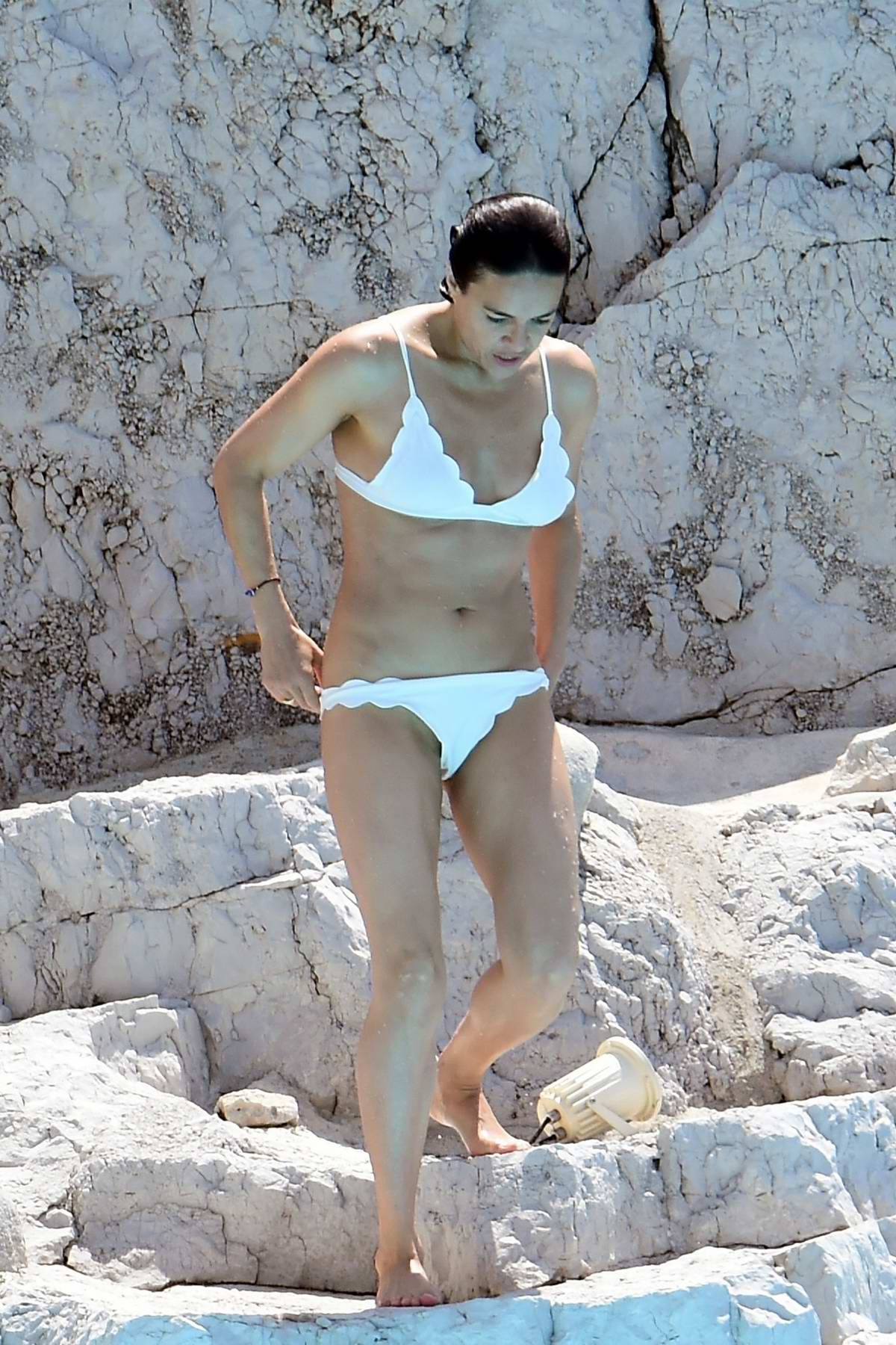 Michelle Rodriguez spotted in a white bikini as she enjoys a swim at the Hotel Du Cap-Eden-Roc in Cannes, France