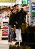 Miley Cyrus takes selfie with a fan while shopping groceries at Whole Foods in Los Angeles