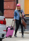 Miranda Lambert and Brendan Mcloughlin seen hauling luggage leaving their apartment in Manhattan, New York City