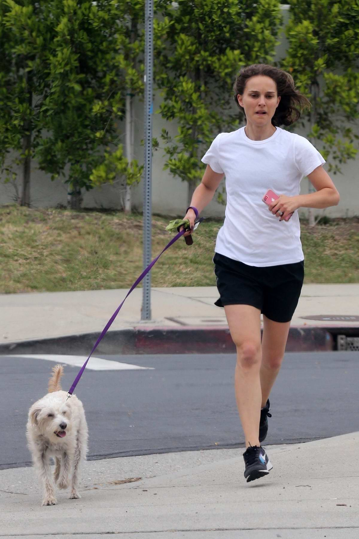 Natalie Portman takes her dog out for a run in Los Angeles