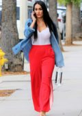 Nikki Bella rocks bright red pants with a white tank top and denim shirt while out on Ventura Boulevard in Los Angeles