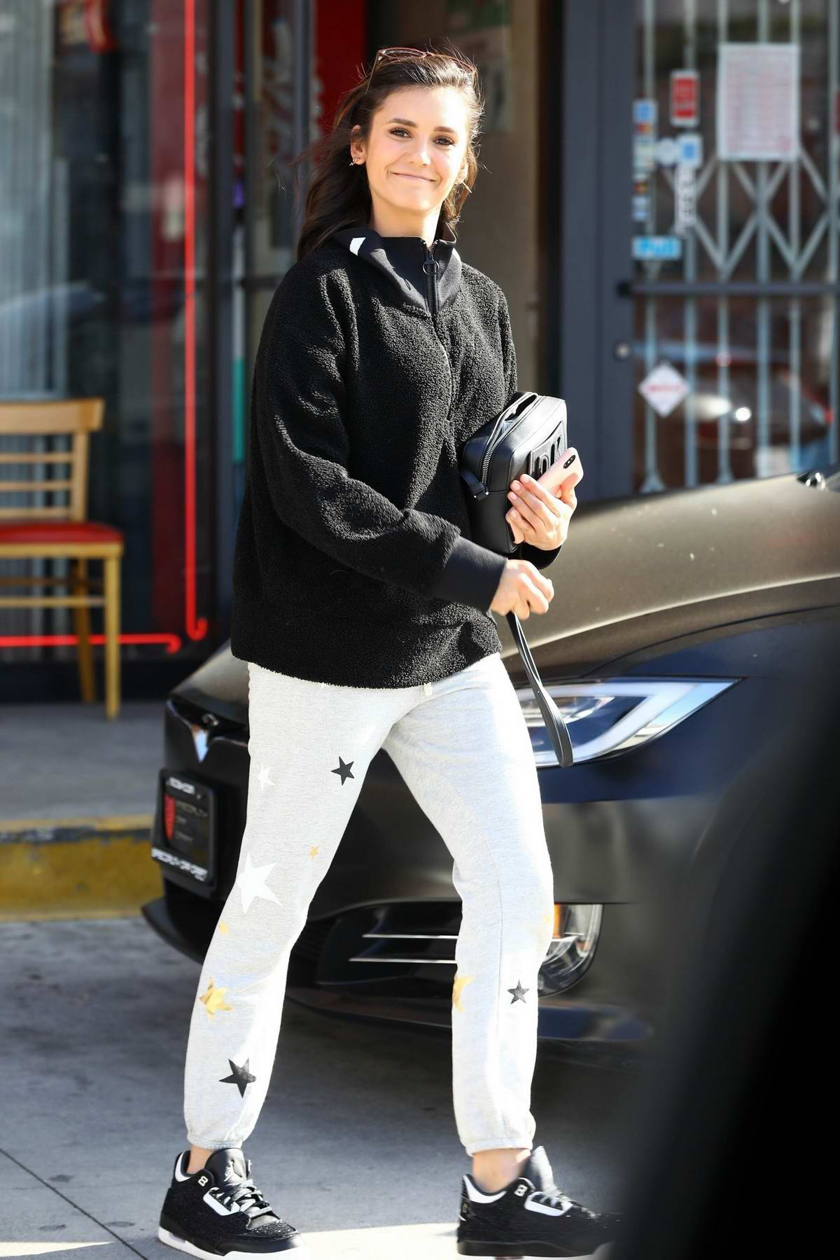 Nina Dobrev is all smiles as she leaves a smoke shop in Hollywood, Los Angeles
