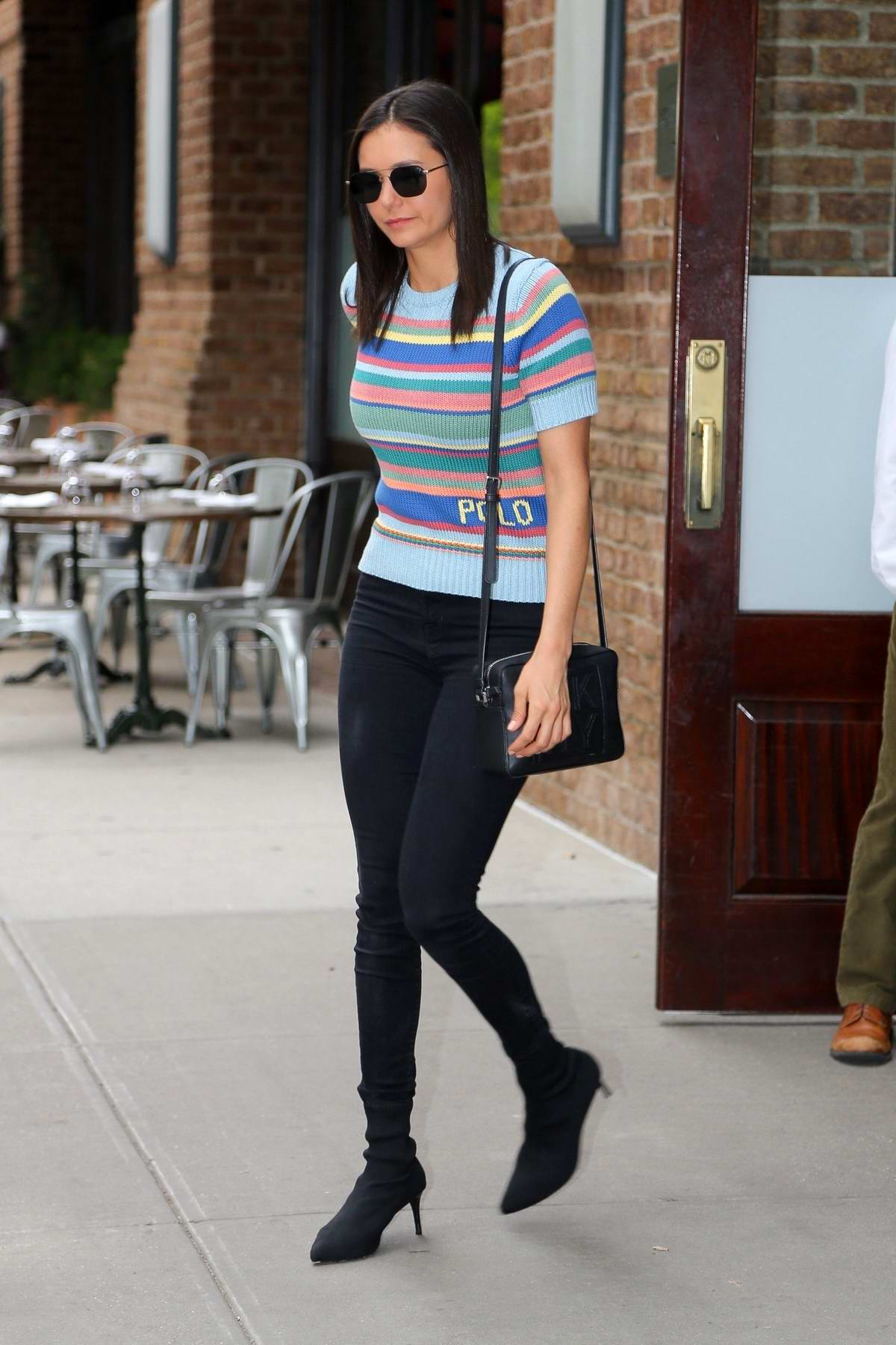 Nina Dobrev looks stylish in a striped top, black jeans and high heels as she leaves the Greenwich Hotel in New York City