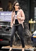 Nina Dobrev looks trendy in a blush colored jacket, black top and skinny jeans as she leaves Bluestone Lane Cafe in Los Angeles