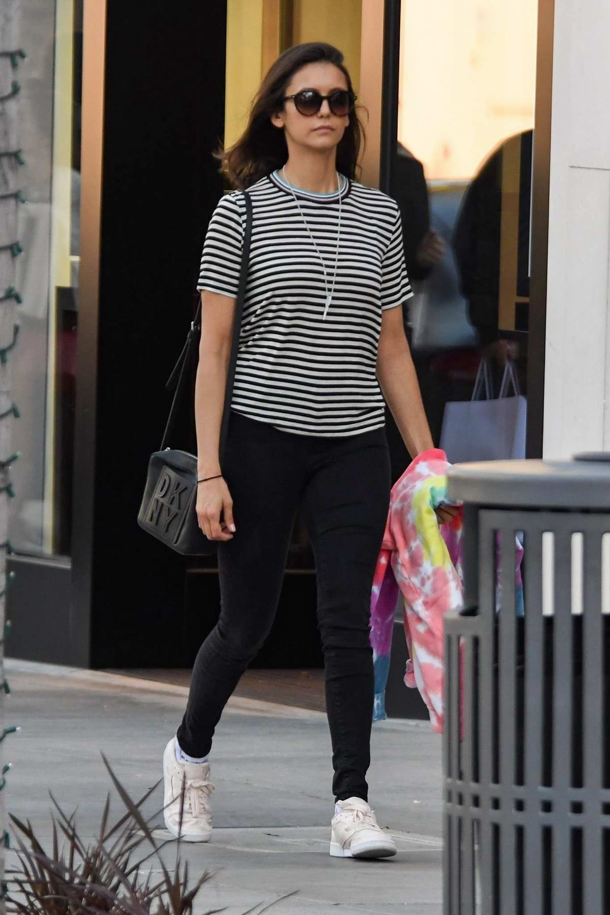Nina Dobrev steps out in a striped top and black jeans while out for some shopping in Los Angeles