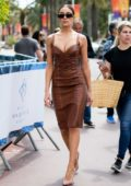 Olivia Culpo looks fashionable in a brown leather dress while out on the Croisette during the 72nd Cannes Film Festival in Cannes, France
