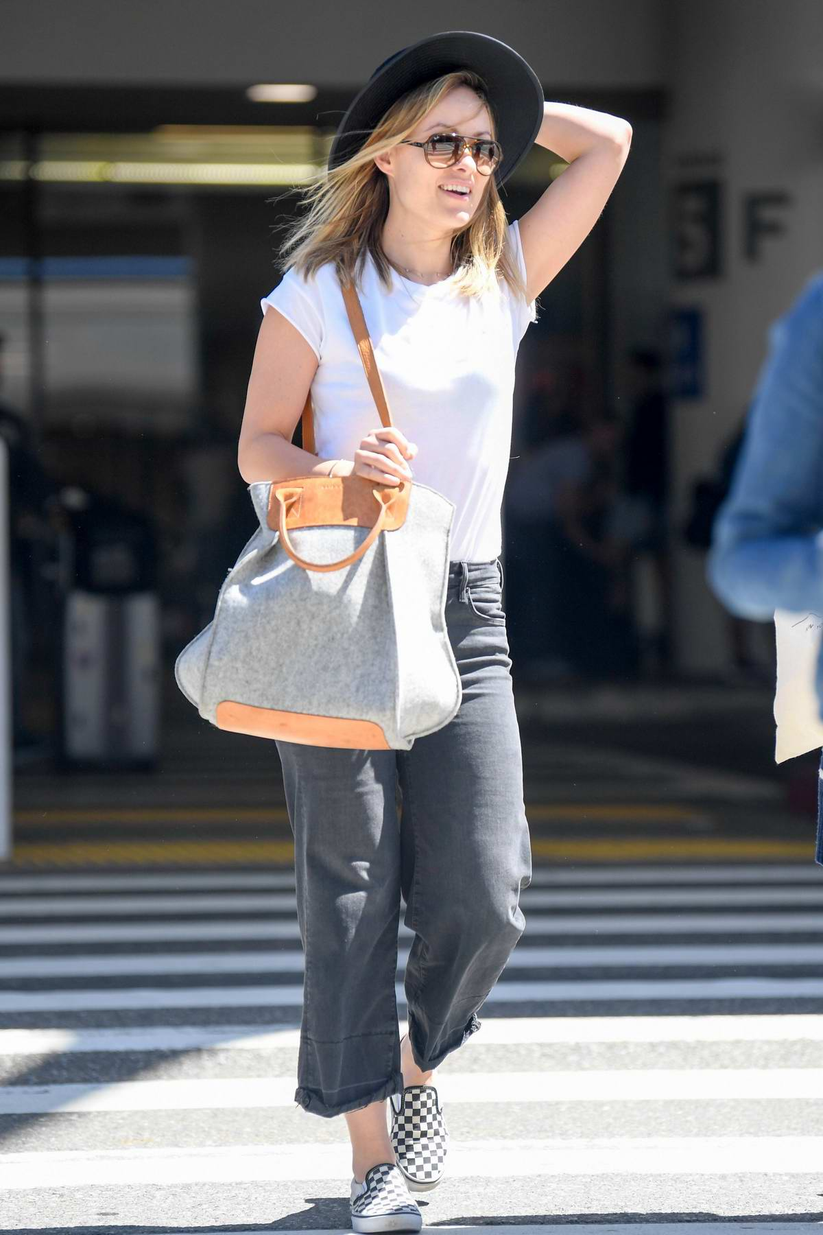Olivia Wilde is all smiles as she arrives at LAX in Los Angeles