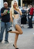 Paris Hilton dazzles in a metallic silver outfit during a music video shoot in Los Angeles